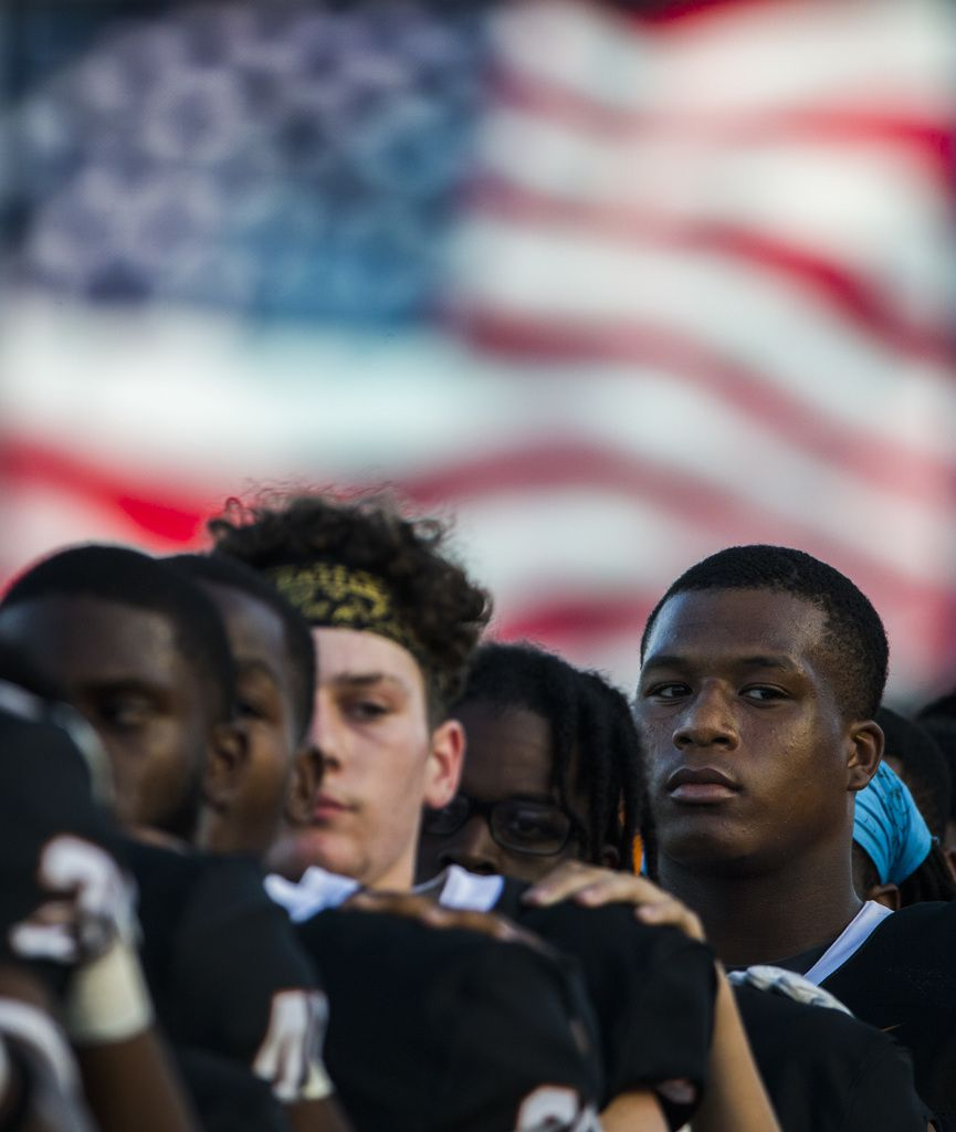 Arlington Bowie football players listen to the national anthem before a high school football game between Flower Mound Marcus and Arlington Bowie on Thursday, August 29, 2019 at Wilemon Field in Arlington. (Ashley Landis/The Dallas Morning News)
