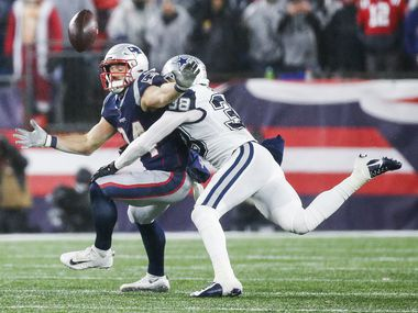 FILE - Cowboys strong safety Jeff Heath (38) takes down New England Patriots running back Rex Burkhead (34) during the second half of a game at Gillette Stadium in Foxborough, Mass., on Sunday, Nov. 24, 2019.