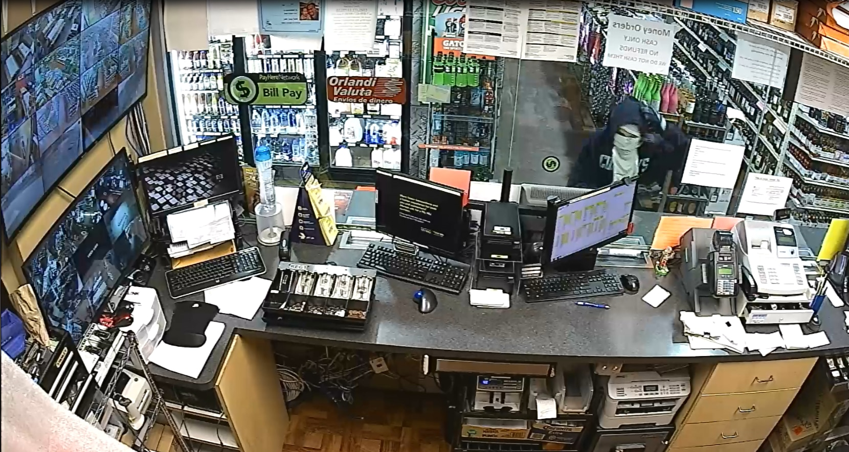 Police released surveillance footage Thursday of the two males they said went into the store with handguns.