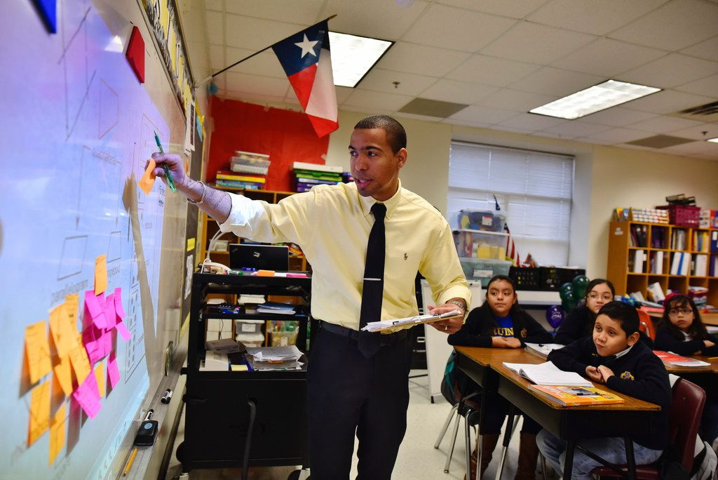 Dallas ISD's teacher evaluation system is one of six nationwide getting results in keeping the best educators and getting them to schools in need, according to a new report from the National Council on Teacher Quality. Here, former DISD teacher of the year Josue Tamarez Torres works on a math problem at Annie Webb Blanton Elementary School.