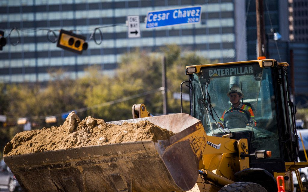 Construction on the expansion of Cesar Chavez Boulevard continued on Wednesday, March 14, 2018, in downtown Dallas.