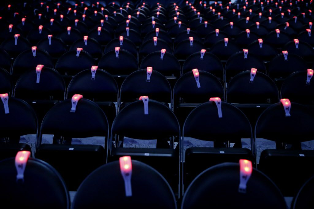 Wristbands sit on the back of chair before the 2015 Academy of County Music Awards Sunday, April 19, 2015 at AT&T Stadium in Arlington, Texas.
