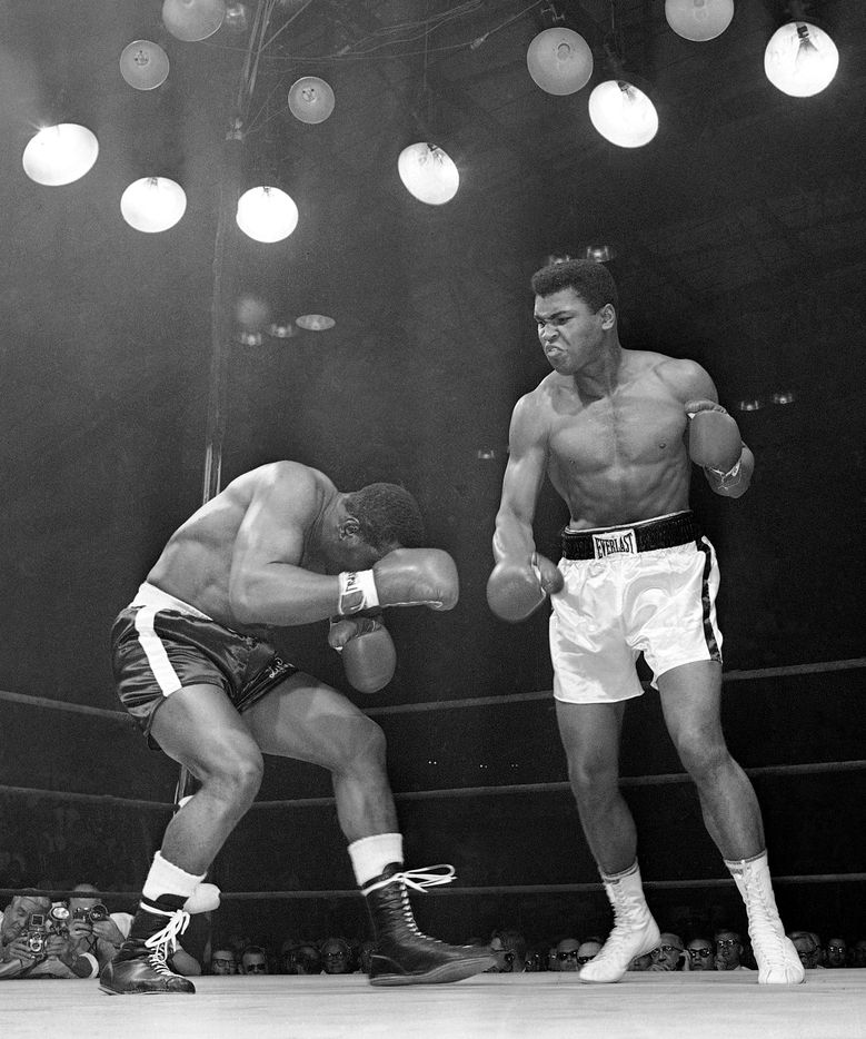 In this May 25, 1965, file photo, challenger Sonny Liston, left, ducks under a blow from heavyweight champion Muhammad Ali in the opening seconds of the first round of their title fight in Lewiston, Maine. Ali knocked Liston out in the first round to retain his title. The bout produced one of the strangest finishes in boxing history as well as one of sports' most iconic moments.