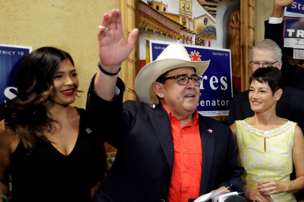 Republican Pete Flores exulted with his daughter Vicky (left) and state Sen. Donna Campbell (right) as he talked to supporters Tuesday. Flores defeated Democrat Pete Gallego to capture what had been a reliably blue state Senate seat in the San Antonio area.