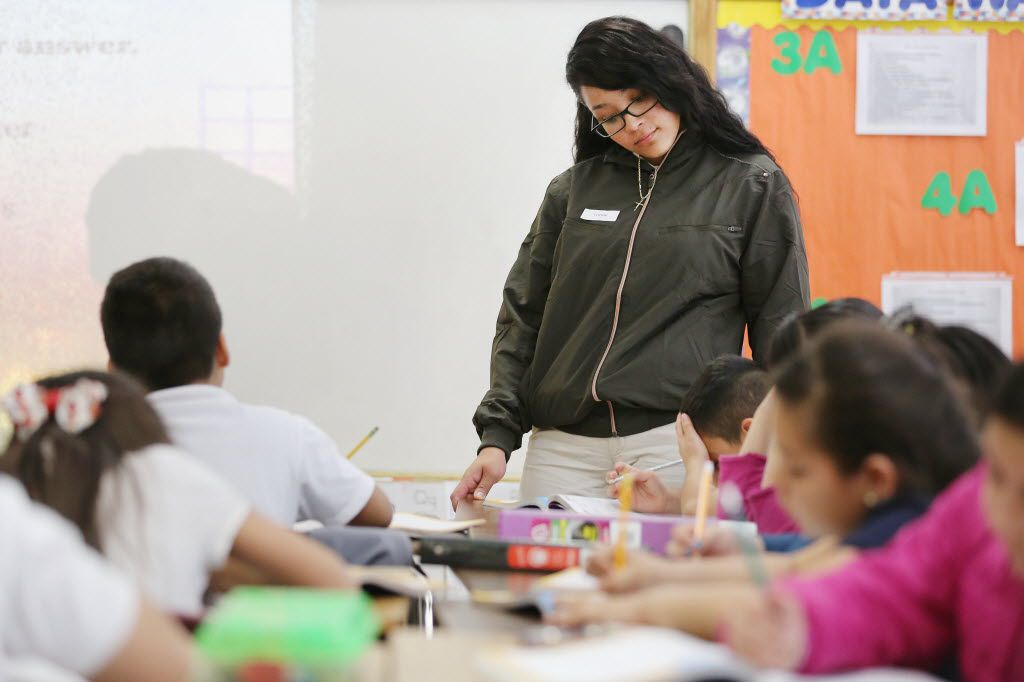 South Oak Cliff High School senior Patricia Alvarado, in a classroom in February, helped to instruct students in a third-grade math class at Carla Oliver Elementary in Dallas. (File Photo/Staff)