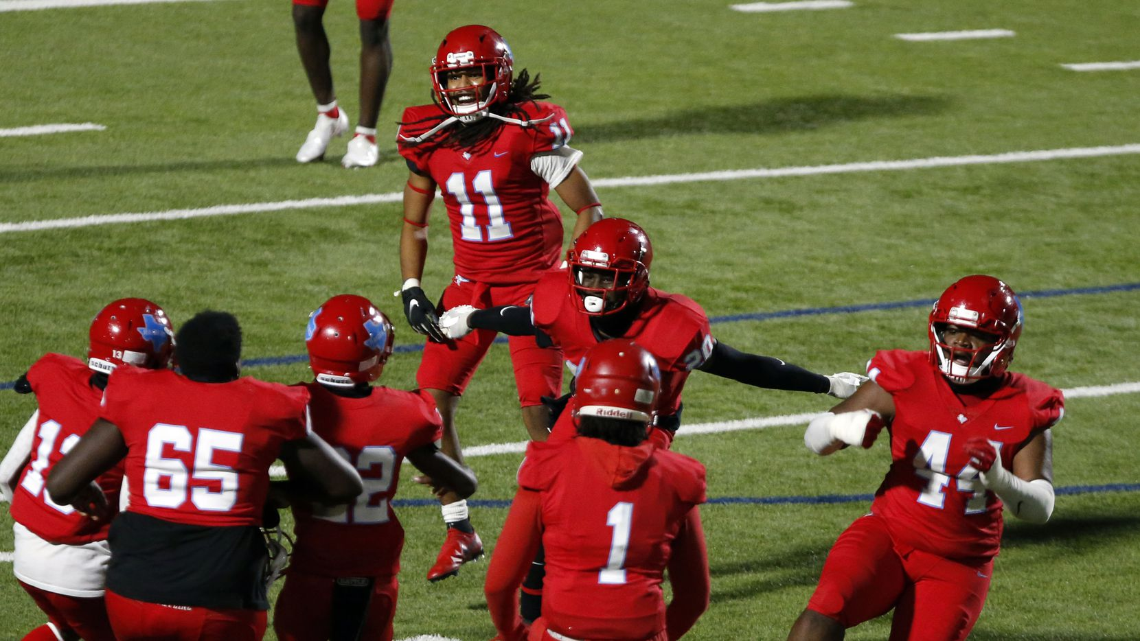 Skyline's Gregory Johnson (20) celebrates his game-ending interception with teammates during the final quarter of a high school football game between against North Mesquite High at Forester Field in Dallas on Thursday, November 19, 2020. Skyline won 31-23.