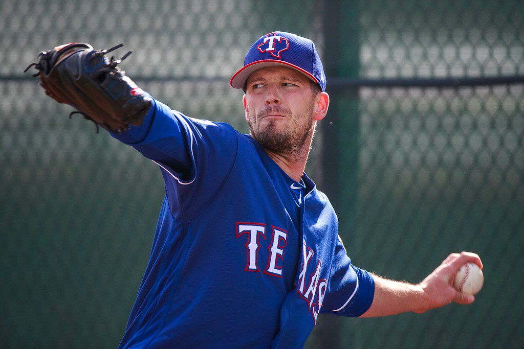 Texas Rangers pitcher Drew Smyly throws in the bullpen during a spring training workout at the team's training facility on Friday, Feb. 15, 2019, in Surprise, Ariz.. (Smiley N. Pool/The Dallas Morning News)