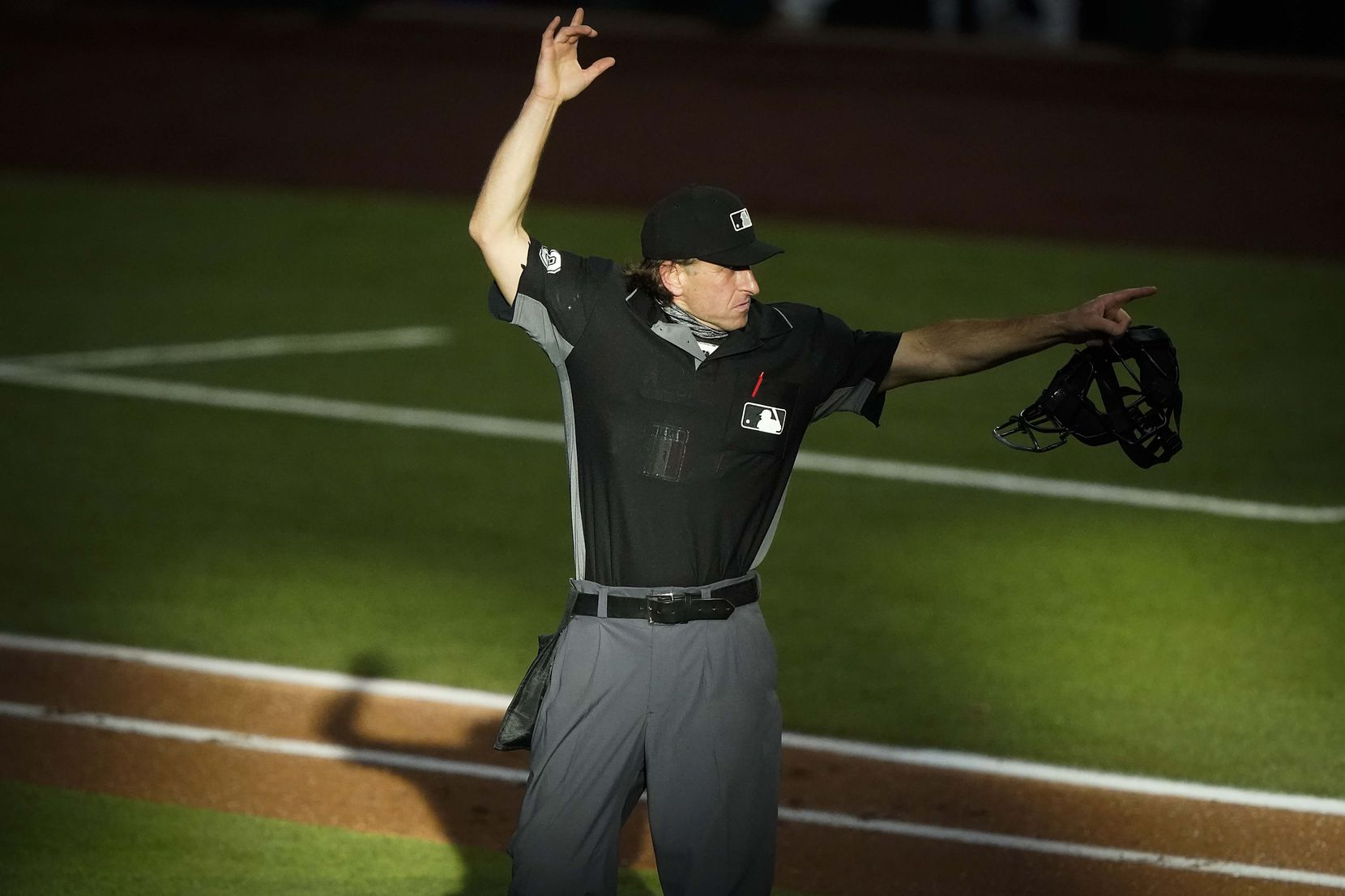 Umpire Chris Guccione signals for the first batter of the second inning of an exhibition game between the Texas Rangers and the Colorado Rockies at Globe Life Field on Wednesday, July 22, 2020.