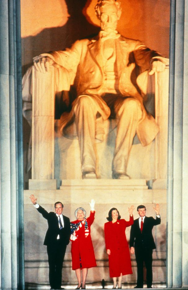 Barbara Bush waves with her husband and Marilyn and Vice-President-elect Dan Quayle at the Lincoln Memorial, during George H.W. Bush's inaugural weekend as U.S. president.