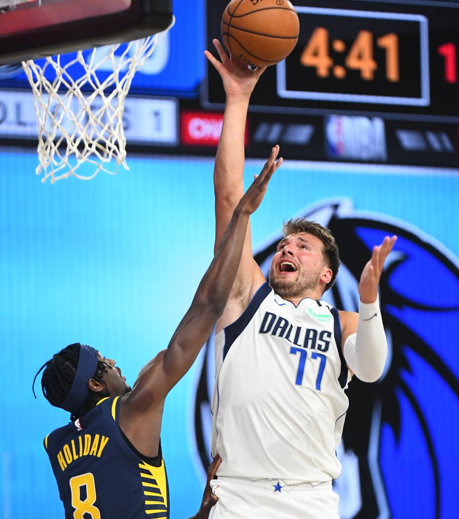 Orlando, FL - JULY 26: Luka Doncic #77 of the Dallas Mavericks shoots the ball against the Indiana Pacers during a scrimmage on July 26, 2020 at HP Field House at ESPN Wide World of Sports in Orlando, Florida.