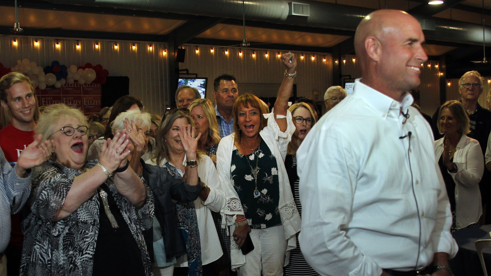 State Rep. Jake Ellzey conducted live television interviews at the Texas Motorplex in Ennis as his supporters cheered after he won his runoff election against Susan Wright on Tuesday.