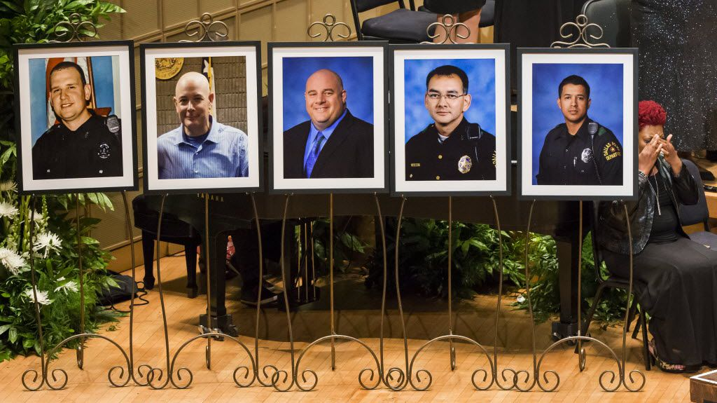 Photos of five officers who died were displayed during during an interfaith memorial service at the Morton H. Meyerson Symphony Center in Dallas on Tuesday, July 12, 2016. The officers were killed last week in an ambush as a Black Lives Matter rally was ending. The victims are (from left) Dallas PD officer Michael Krol, DART officer Brent Thompson, Dallas PD officer Lorne Ahrens, Dallas PD officer Michael Smith, and Dallas PD officer Patrick Zamarripa.