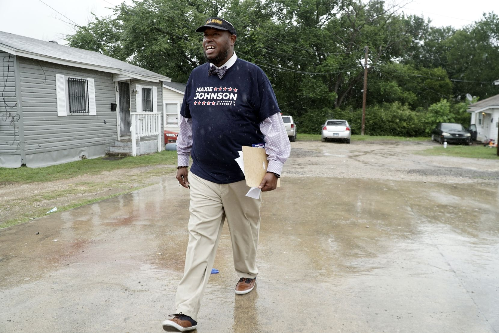 Maxie Johnson canvases for voters in the Cedar Crest neighborhood in Dallas, Texas on Thursday May 20, 2021.(Lawrence Jenkins/Special Contributor)