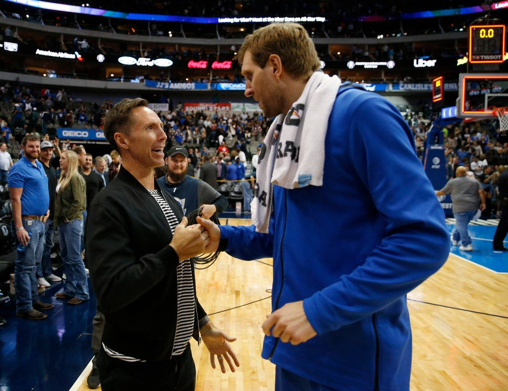 FILE - Former teammate Steve Nash and Dallas Mavericks forward Dirk Nowitzki (41) talk after a game against the Philadelphia 76ers during the second half of play at the American Airlines Center in Dallas on Monday, April 1, 2019. (Vernon Bryant/The Dallas Morning News)