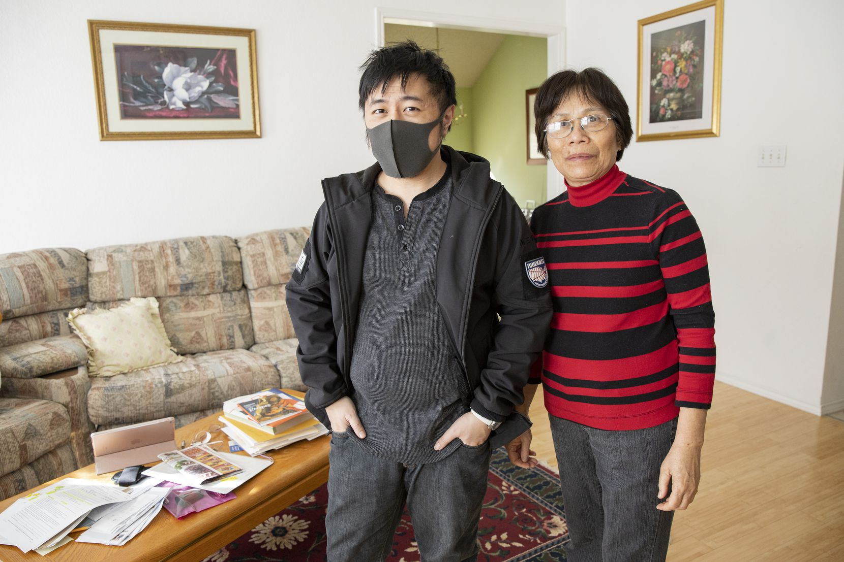 Warren Lee and his mother, Sho Lee, pose for a photo at home in Euless on Thursday . After nearly 11 months overseas, Warren returned home this week.