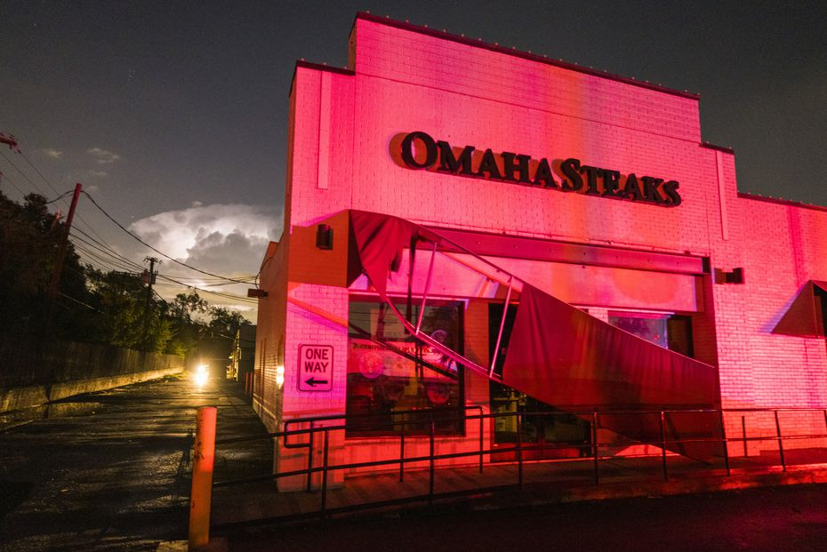 The awning outside of Omaha Steaks was ripped down by strong winds near the intersection of Royal and Preston.
