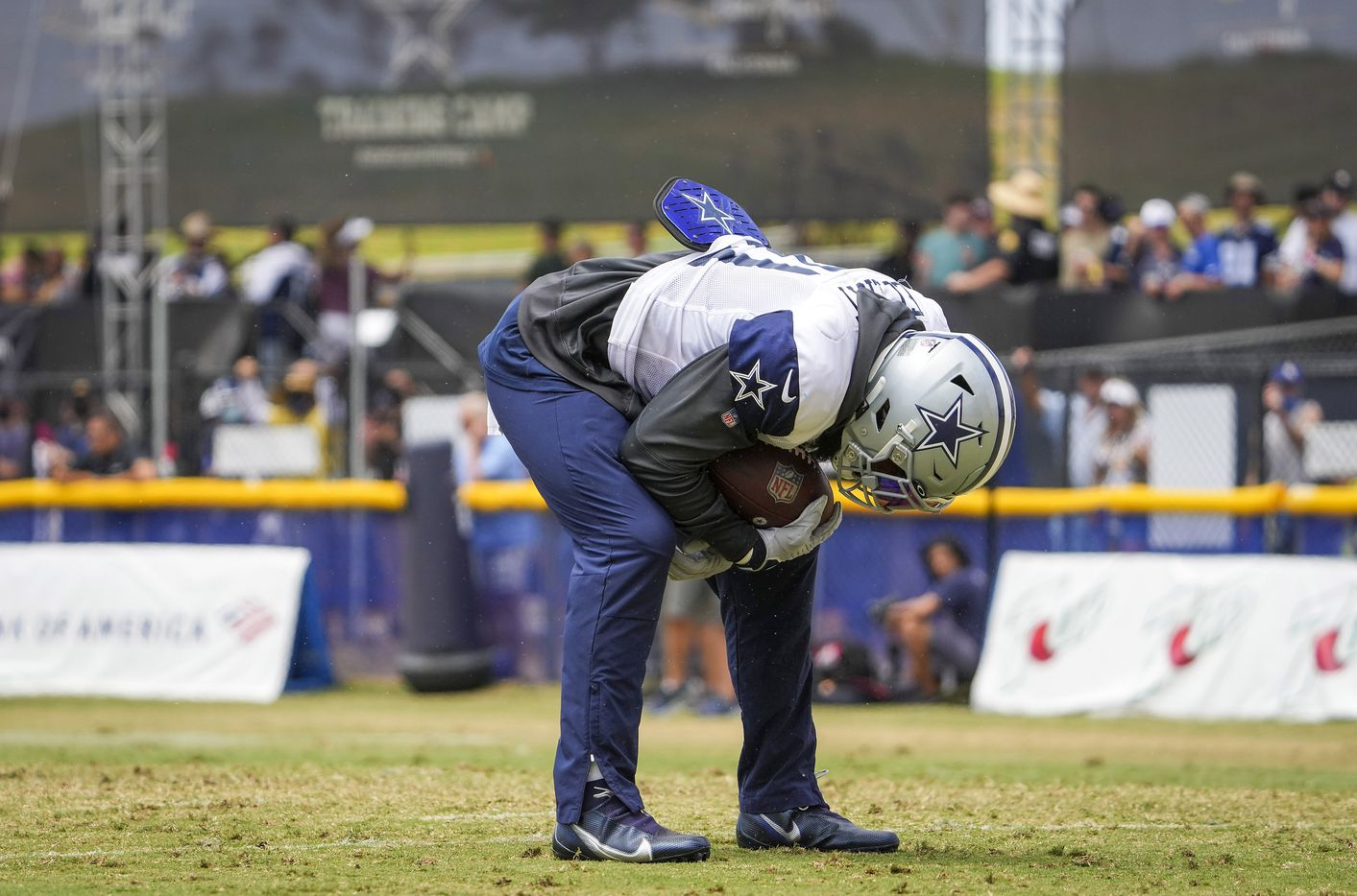 Dallas Cowboys running back Ezekiel Elliott  catches his breath after a long run during a practice at training camp on Wednesday, Aug. 11, 2021, in Oxnard, Calif.