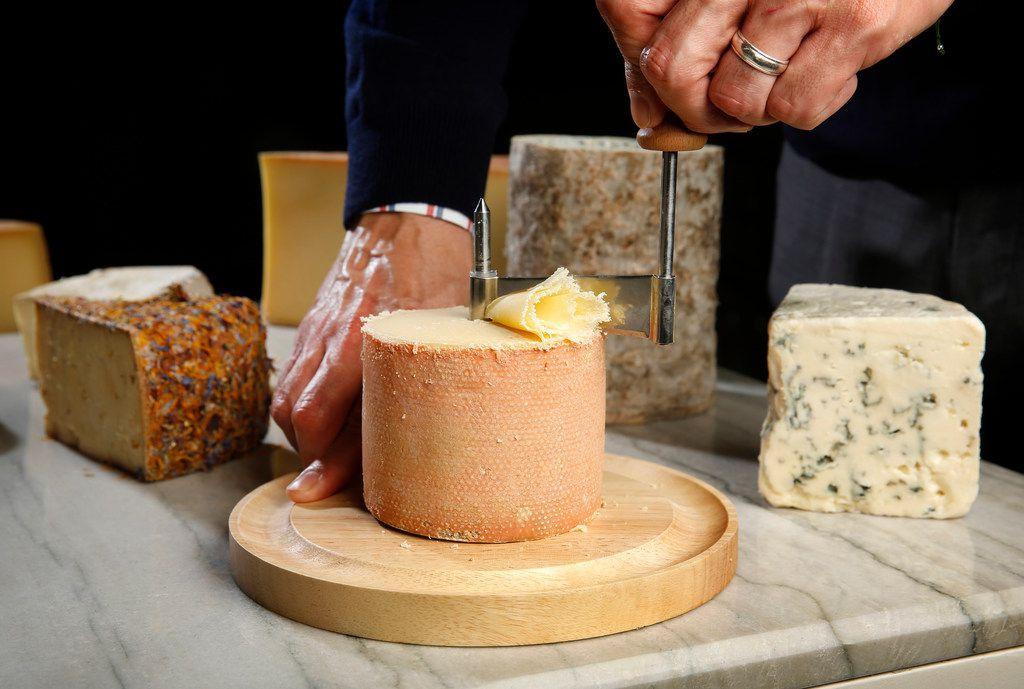 The cheese cart includes delicate Tête de Moine, a Swiss cow's milk cheese that is shaved into feathery rosettes.