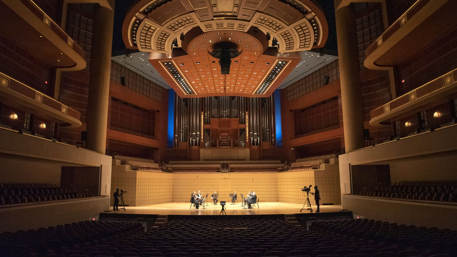 Camera operators, far-left and far-right, record the Dallas Symphony Orchestra as they perform Mozart Serenade in C minor, K. 388 for wind octet, part of their Summer Chamber Music, at the Morton H. Meyerson Symphony Center in Dallas, Saturday, June 13, 2020.