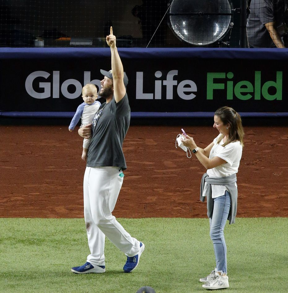 Dodgers starting pitcher Clayton Kershaw waves to fans behind home plate as he celebrates their World Series win over the Rays in Game 6 at Globe Life Field in Arlington on Oct. 27, 2020.