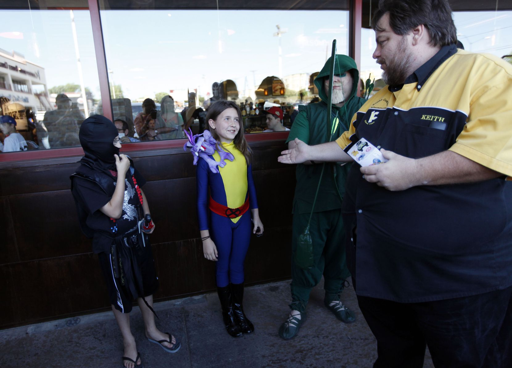 Keith Colvin, right, owner of Keith's Comics awarded Reese Kirkham, 9, of Dallas, dressed as comic book character Kitty Pryde, first place in a costume contest during the Free Comic Book Day at Keith's Comics on Mockingbird Lane in Dallas in 2013.