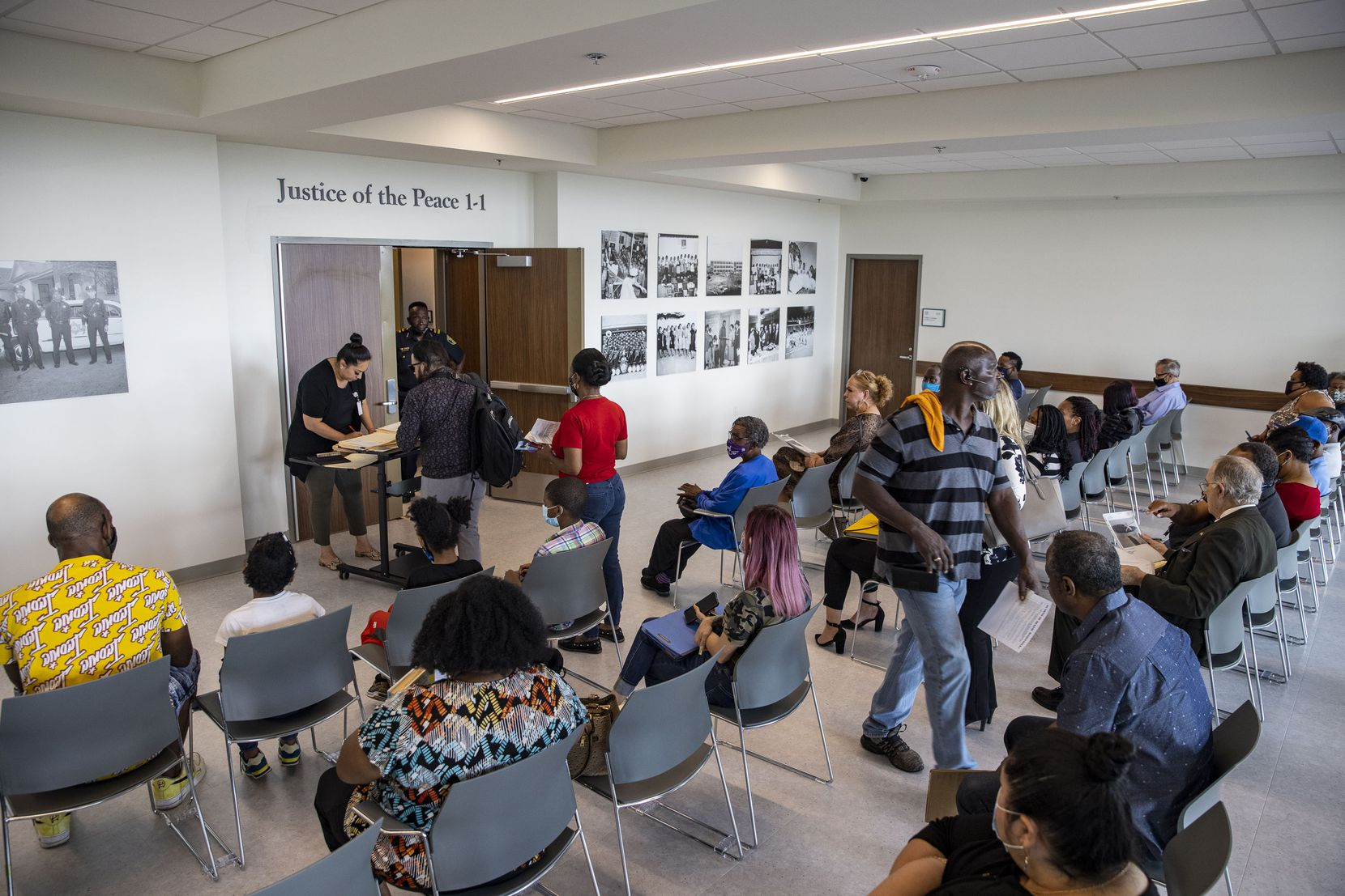 Defendants facing eviction waited for their cases to be heard at the justice of the peace courts in southern Dallas on June 28.