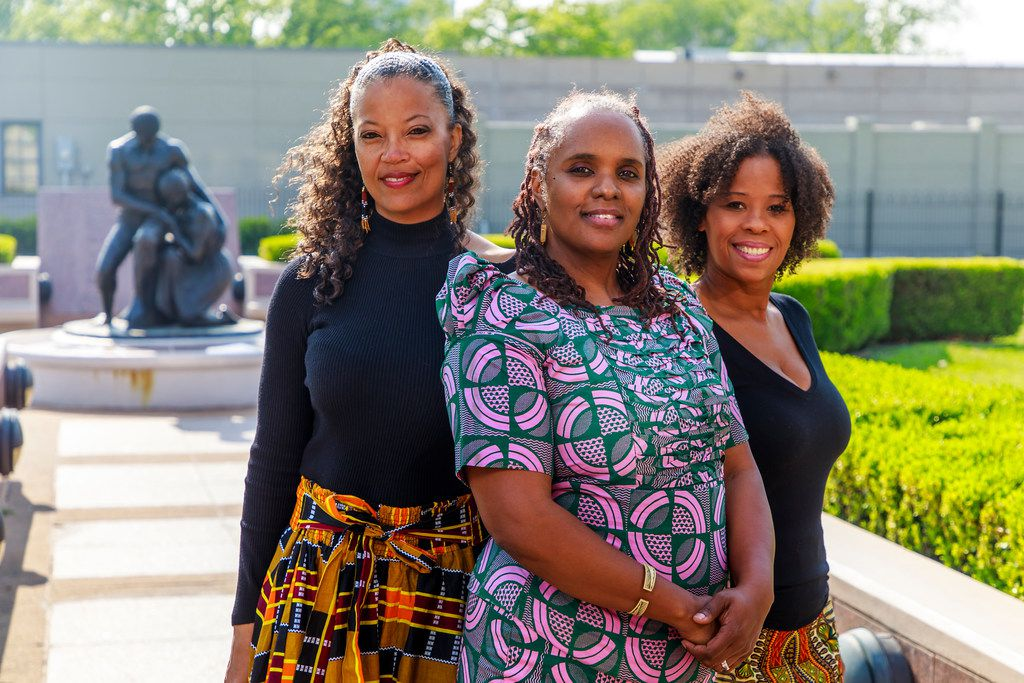 From left: Soul Rep Theatre Company co-founders Tonya Davis-Holloway, Anyika McMillan-Herod and Guinea Bennett-Price at the Freedman's Cemetery Memorial in Dallas, a black burial site that inspired their company's original production The Freedmans.  Soul Rep is presenting this play, which mixes true and imagined stories of the people buried at the cemetery, as part of the Elevator Project series at the Wyly Theatre.