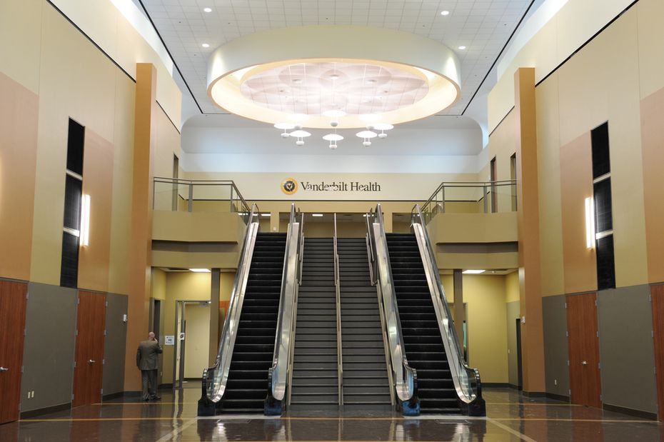 After photo of interior of One Hundred Oaks mall in Nashville, Tenn. The upper level had been a food court. It now leads to a waiting area for offices of Vanderbilt Health.