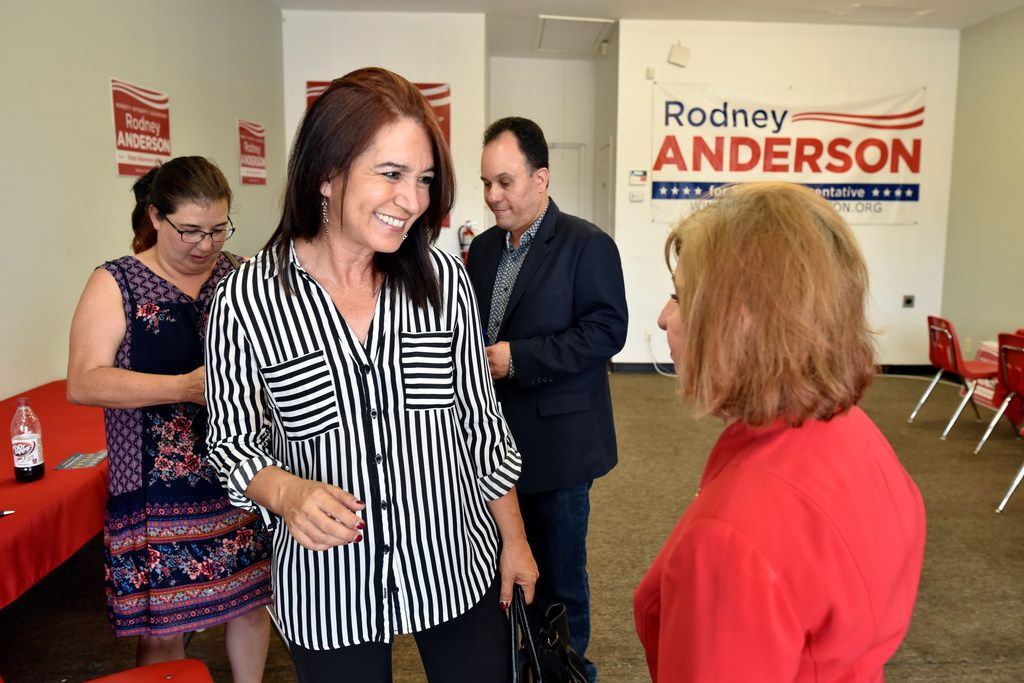 Nancy Richer (center) Hispanic engagement director for the Dallas County Republican Party, speaks with longtime Republican Margaret Ann Lopez at the office of Rep. Rodney Anderson in Irving in August.