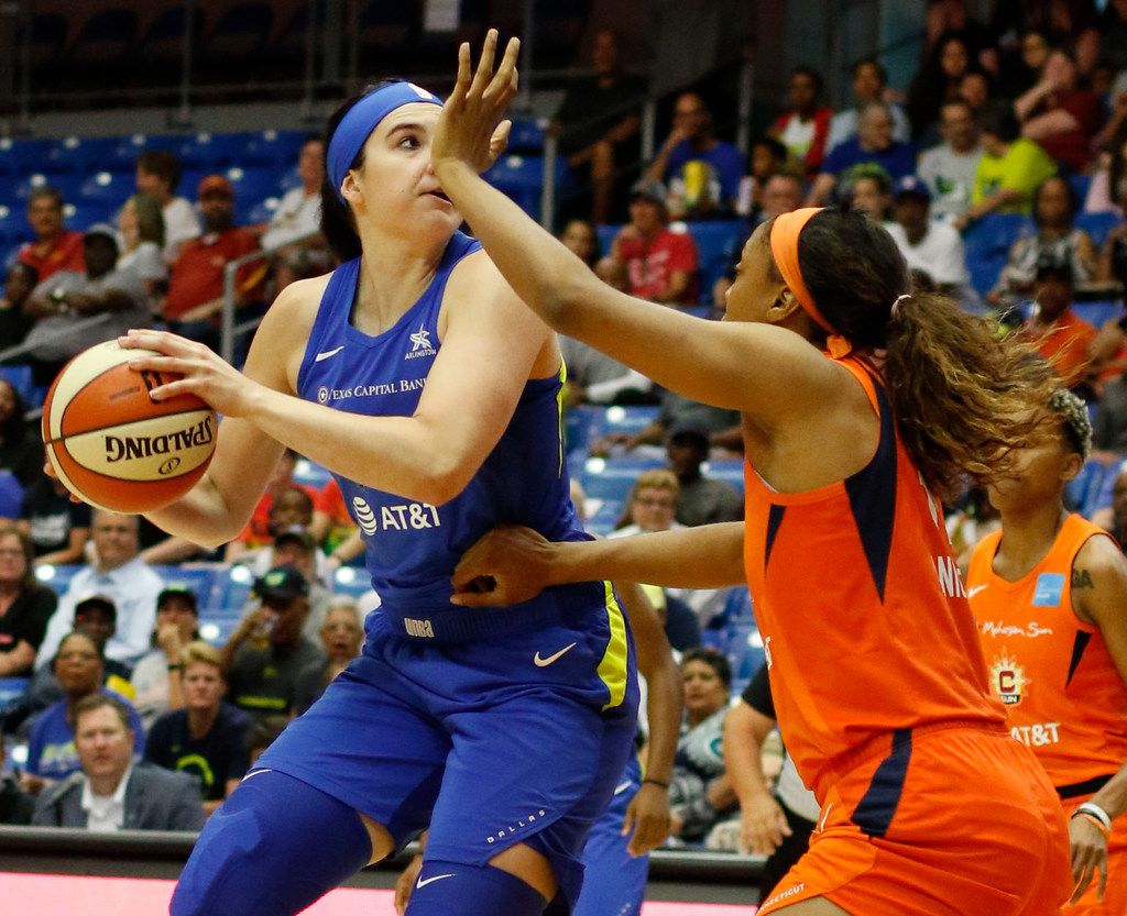 Dallas Wings forward Megan Gustafson (13), left, looks to shoot as she is defended by the aggressive defense of Connecticut Sun forward Kristine Anigwe (31) during first half action. The two teams played their WNBA game at UT-Arlington's College Park Center in Arlington on June, 26, 2019.  (Steve Hamm/ Special Contributor)