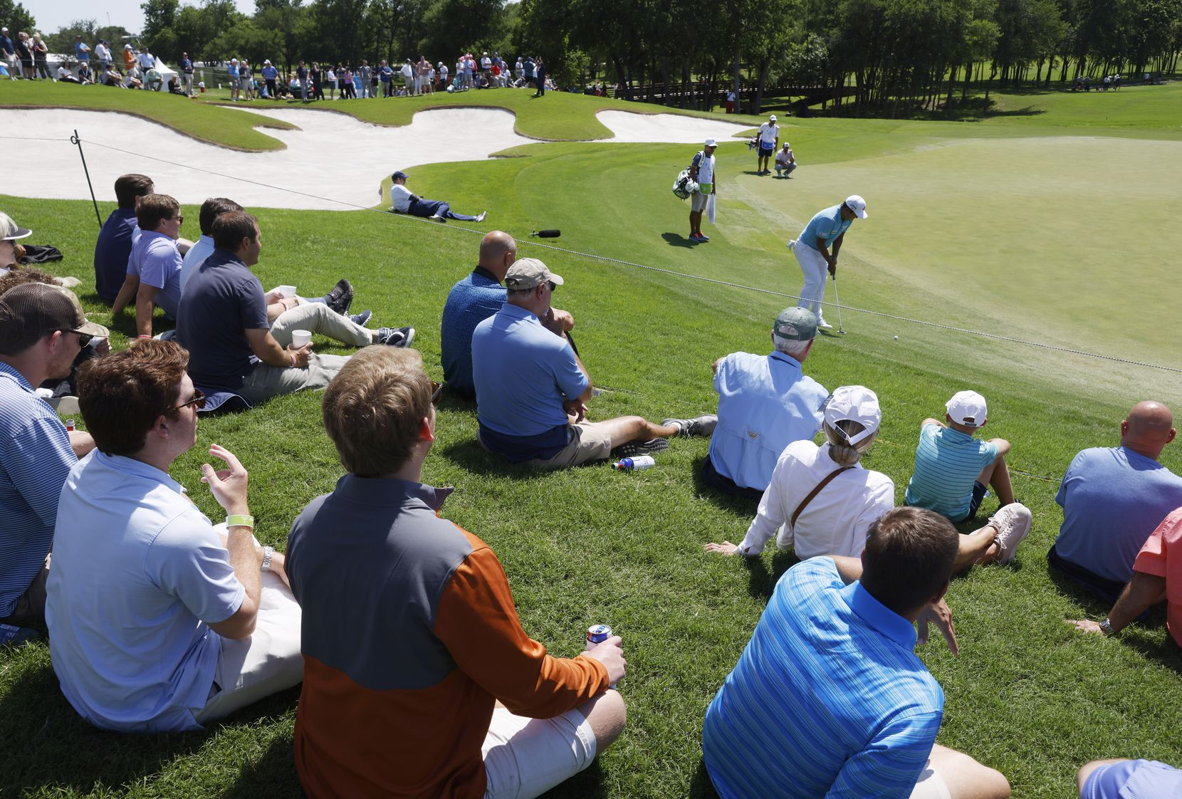 Fans watched as eventual winner K.H. Lee hit a putt on the 12th hole during Round 1 of the AT&T Byron Nelson at TPC Craig Ranch on May 13. The PGA's limits on attendance allowed fans a more intimate view of the players.