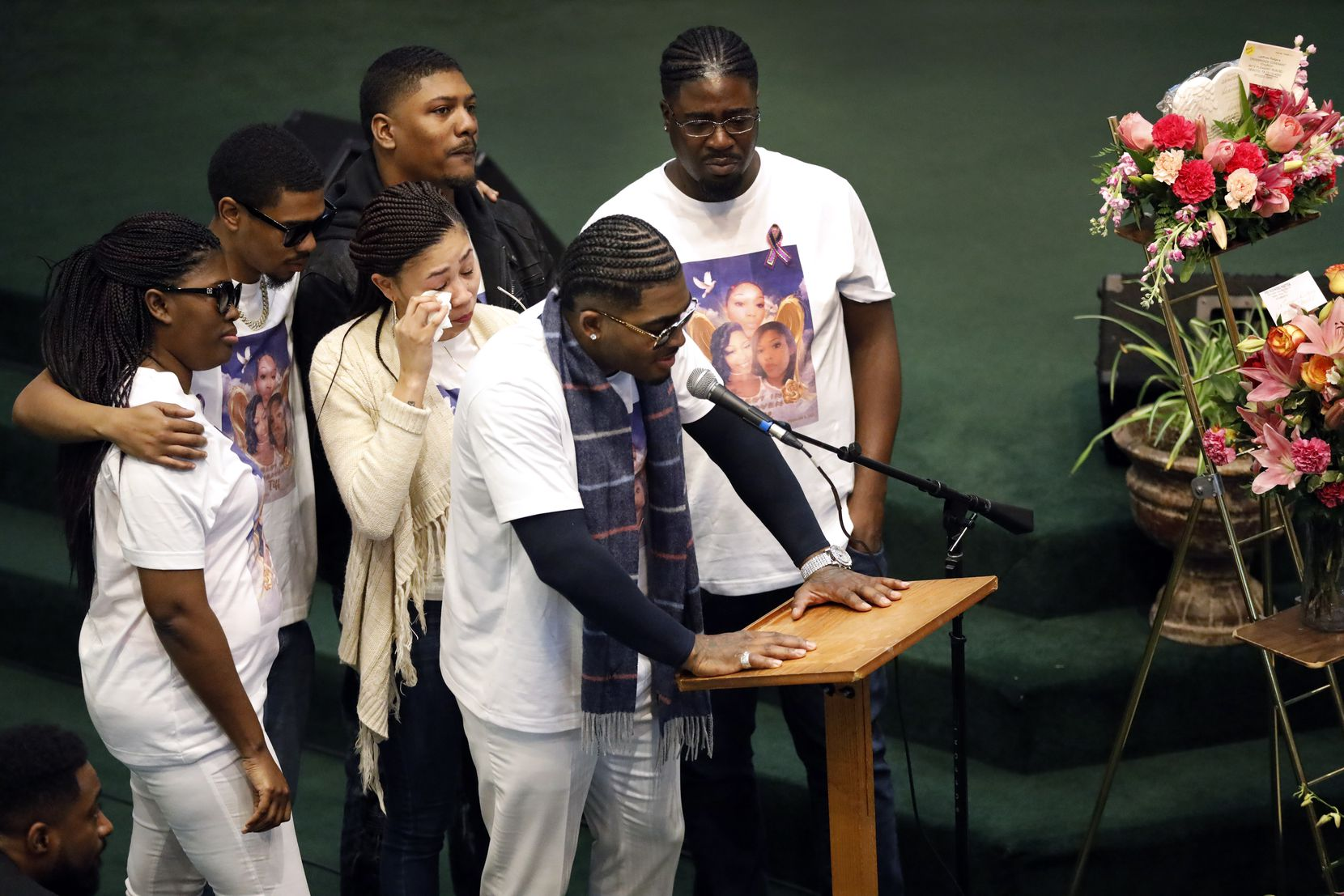Brothers and sisters of LaTiffiney Rodgers, clockwise from Ramone Compton at microphone, Danielle Roberson (center), Keysha Price, Arthur Rodgers, Carl Rodgers and ZaModeric Odom shared stories with mourners a funeral service Feb. 22 in DeSoto.