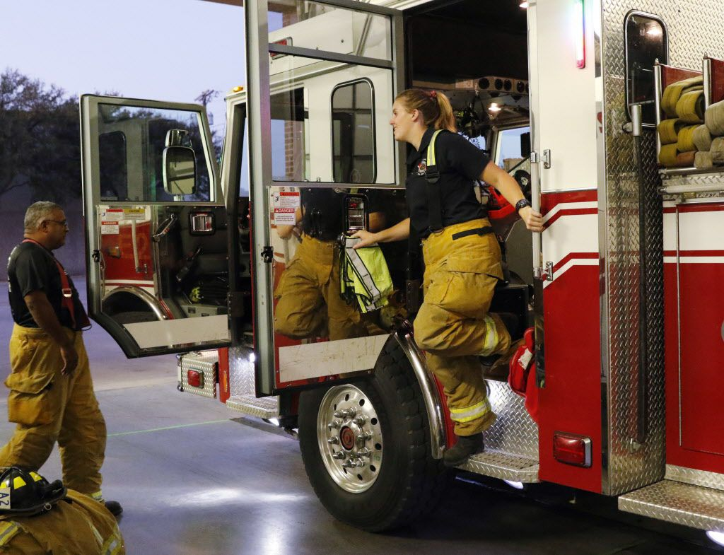 Andrew Muniz, left, driver of the fire truck and Steph Bouillon, 27, a Garland firefighter-Paramedic of station 2, returned to the station after a call as on Thursday, October 15, 2015. When Steph Bouillon completed the Garland fire academy earlier this year, she became just one of two women hired onto the department in nearly 15 years. (David Woo/The Dallas Morning News)