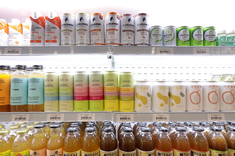 The beverage cases at Feed Me Pronto include non-alcoholic drinks (pictured here) as well as a wall of trendy beers, wines and hard seltzers.