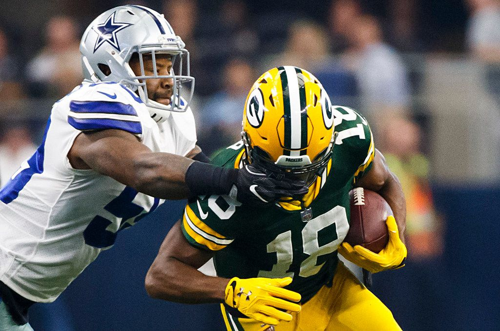 Dallas Cowboys linebacker Anthony Hitchens (59) is called for a facemask penalty as he brings down Green Bay Packers wide receiver Randall Cobb (18) during the first half of an NFL football game at AT&T Stadium on Sunday, Oct. 8, 2017, in Arlington, Texas. (Smiley N. Pool/The Dallas Morning News)