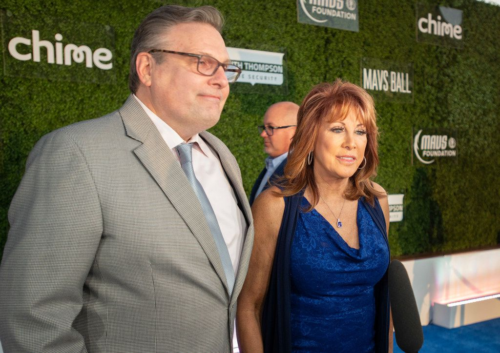 Mavs General Manager Donnie Nelson and Nancy Lieberman pause on the blue carpet prior to the Mavs Ball Million Air in Addison, Texas on March 7, 2020. (Robert W. Hart/Special Contributor)