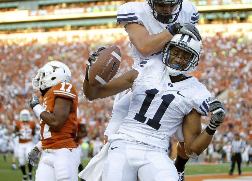AUSTIN, TX - SEPTEMBER 10:  Wide receiver Ross Apo #11 of the BYU Cougars celebrates a second quarter touchdown pass against the Texas Longhorns with teammate J. D. Falslev #12 on September 10, 2011 at Darrell K. Royal-Texas Memorial Stadium in Austin, Texas.  (Photo by Erich Schlegel/Getty Images) ORG XMIT: 120031572 12142011xSPORTS