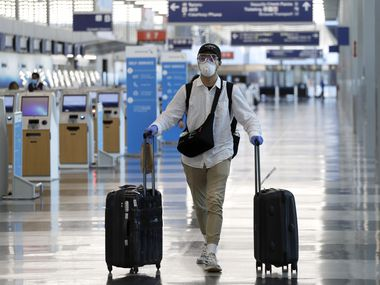 A traveler wears a mask and protective goggles as he walks through Terminal 3 at O'Hare International Airport on June 16, 2020, in Chicago.