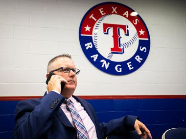Texas Rangers Senior Director of Amateur Scouting Kip Fagg talks on the telephone after the team announced the signings of several of the club's draft picks from last week's MLB draft at Globe Life Park on Tuesday, June 12, 2018, in Arlington.