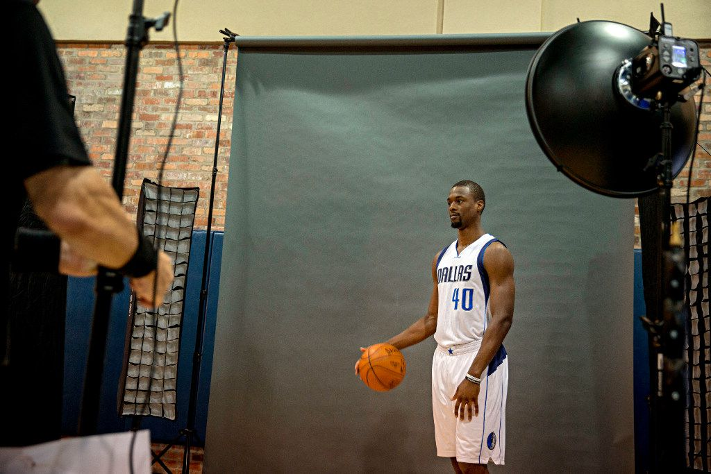 Dallas Mavericks forward Harrison Barnes waits as USA TODAY Sports Images photographer Jerome Miron makes adjustments to his lights during the team's media day Monday, September 26, 2016 at the American Airlines Center in Dallas. (G.J. McCarthy/The Dallas Morning News)