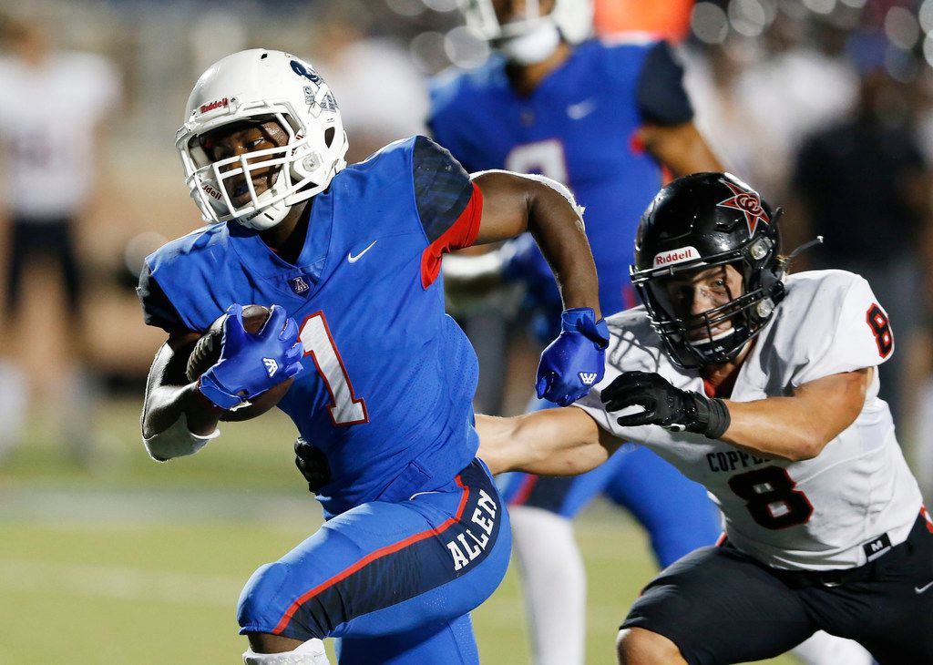 Allen's Celdon Manning (1) rushes for the go-ahead touchdown as Coppell's Canon Peters (8) attempts to tackle him  during the fourth quarter of play at Eagle Stadium in Allen, Texas on Friday, September 13, 2019. Allen defeated Coppell 28-21. (Vernon Bryant/The Dallas Morning News)