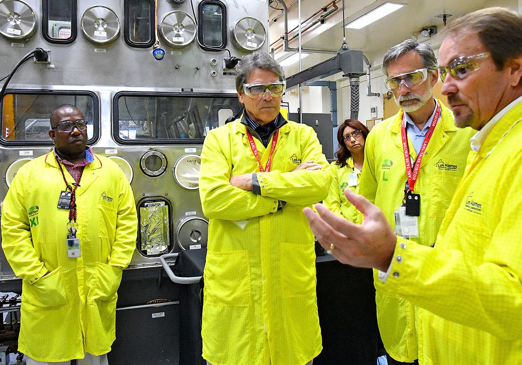 Energy Secretary Rick Perry (center) fell victim to an Instagram hoax this week. He was good-natured about the mistake. (Los Alamos National Laboratory via AP)