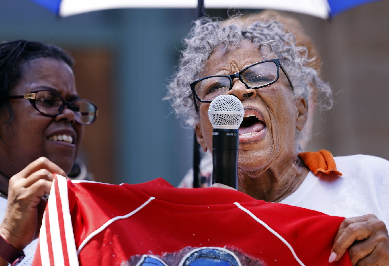 After cooling down from her march, Opal Lee, 94, (right) spoke to supporters outside the Tarrant County Courthouse in downtown Fort Worth, Saturday morning, June 19, 2021.