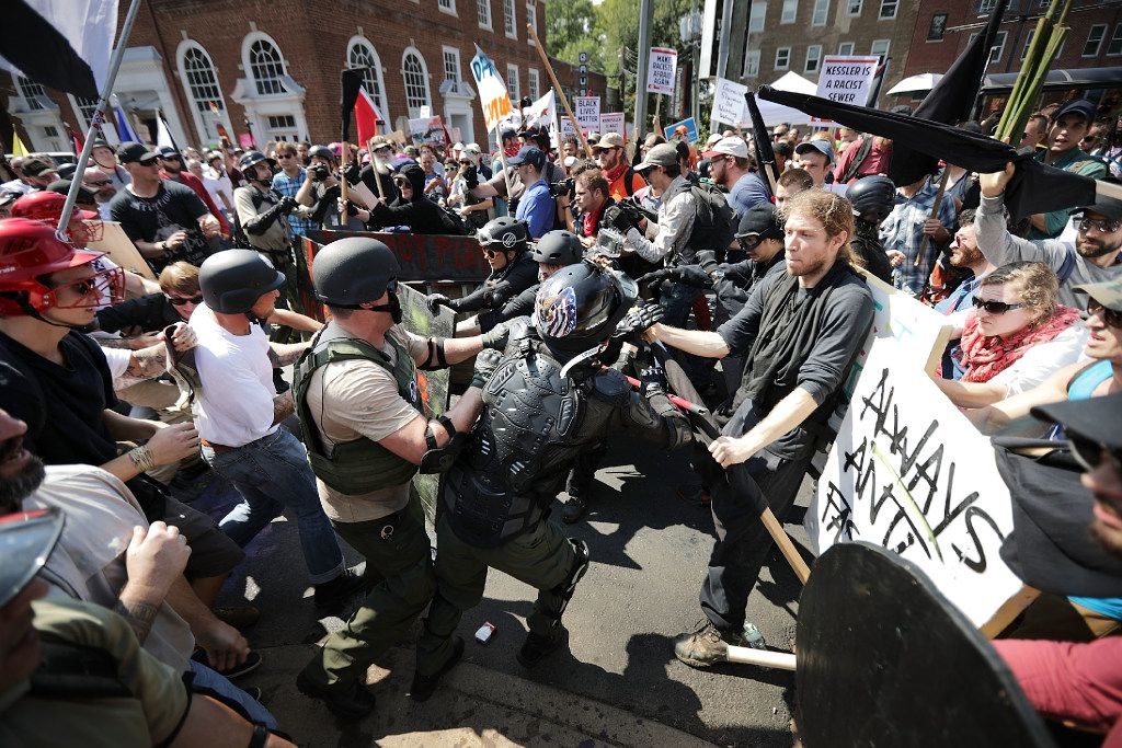 "CHARLOTTESVILLE, VA - AUGUST 12:  White nationalists, neo-Nazis and members of the ""alt-right"" clash with counter-protesters as they enter Lee Park during the ""Unite the Right"" rally August 12, 2017 in Charlottesville, Virginia. After clashes with anti-fascist protesters and police the rally was declared an unlawful gathering and people were forced out of Lee Park, where a statue of Confederate General Robert E. Lee is slated to be removed.  (Photo by Chip Somodevilla/Getty Images) *** BESTPIX ***"