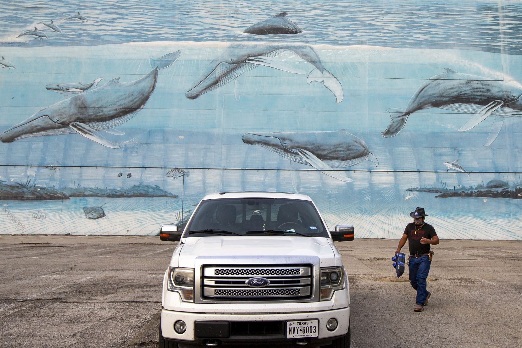 "After recent advertising posters came down, a mural painted in 1999 by the artist and conservationist Wyland is visible on Tuesday, April 21, 2020 in downtown Dallas. The mural is part of a series of 101 he did around the world called ""Whaling Walls."""