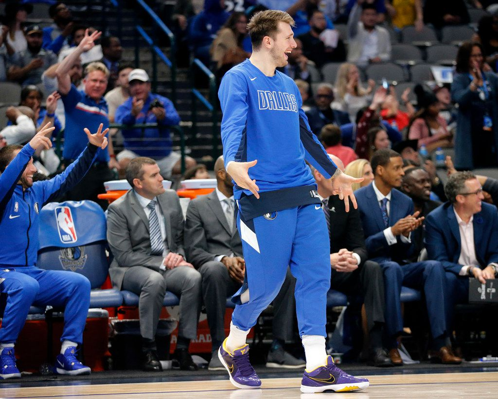 Dallas Mavericks forward Luka Doncic comes off the bench during the fourth quarter to celebrate a teammates three-pointer against Golden State Warriors at the American Airlines Center in Dallas, Wednesday, November 20, 2019. (Tom Fox/The Dallas Morning News)