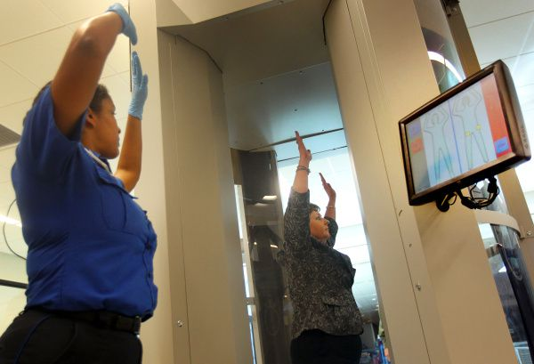 TSA employees demonstrate new body scanning technology at Dallas Love Field. The machines scan travelers in one second and highlight any security threats on an overhead readout. The airport was second in guns found on travelers or in their bags at security checkpoints.