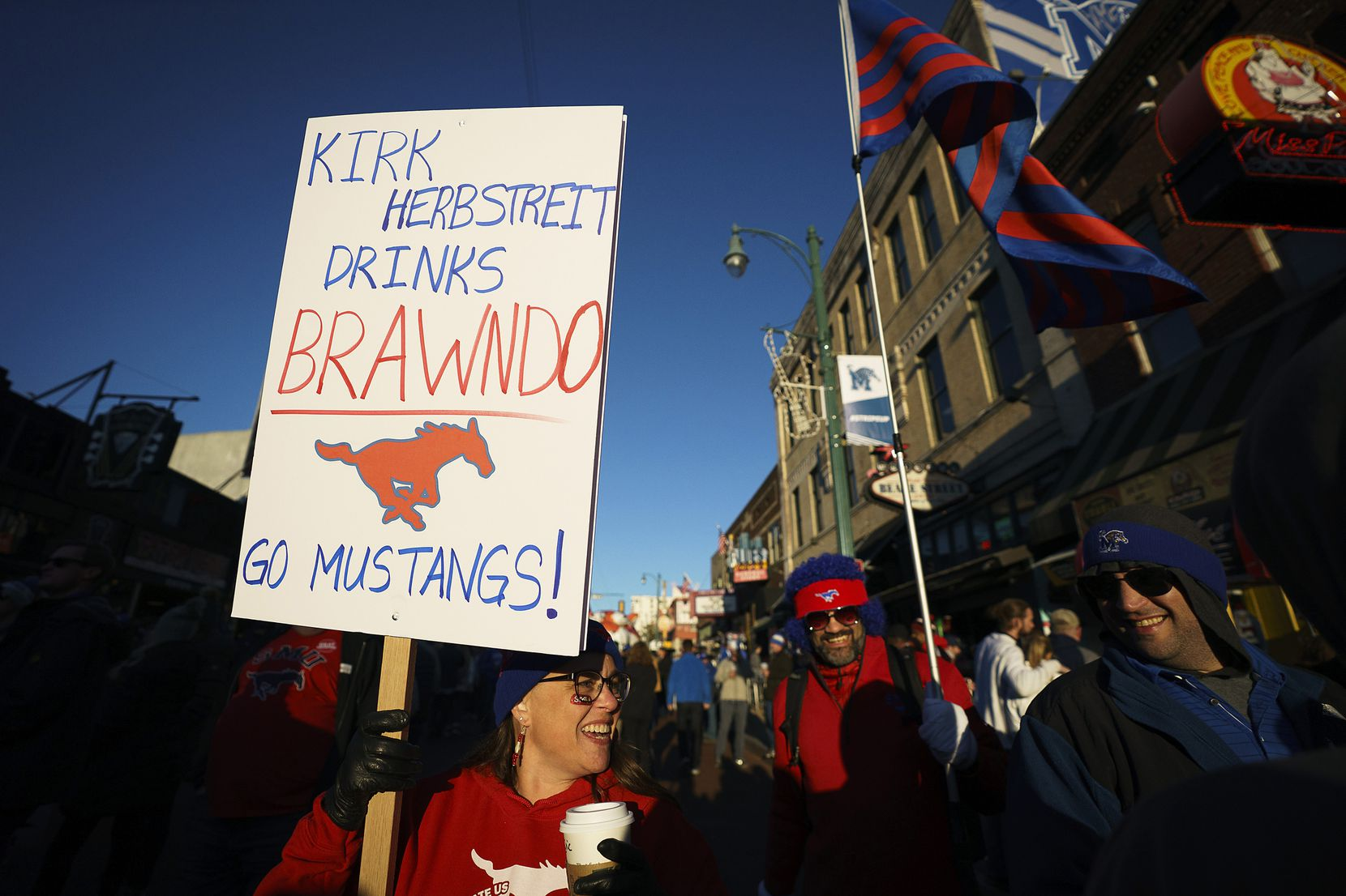 SMU fans Janet (left) and Eric (center) Stephens