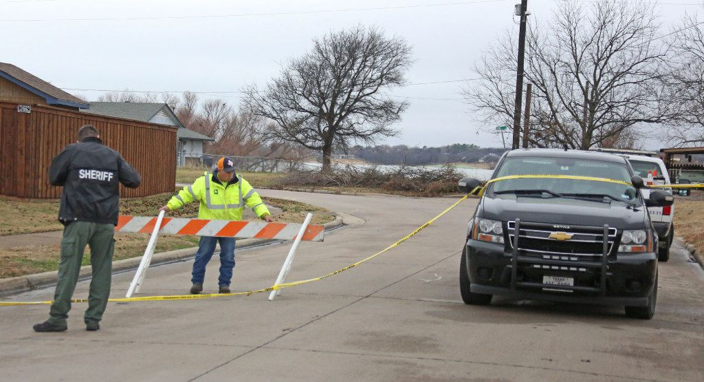 Officials barricade the streets in the neighborhood where Detective Jerry Walker was shot. (Louis DeLuca/Staff Photographer)