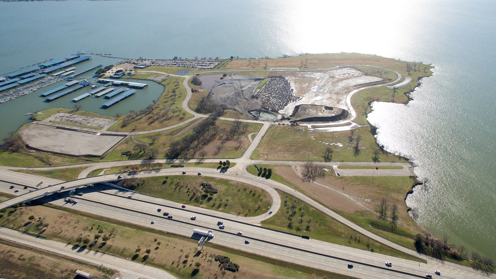 This aerial view of the south side of Interstate 30 shows the still-undeveloped portion of the Bayside project, which originally was planned to include a crystal lagoon, show fountain and trolley.